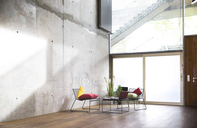 Sitting area in a loft at concrete wall — Stock Photo