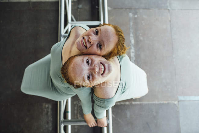 Redheaded twins looking at camera — стоковое фото
