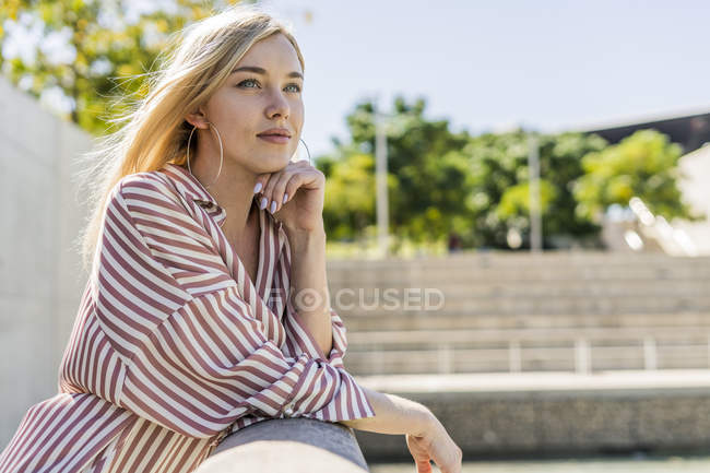 Portrait of blond young woman looking at distance — Stock Photo