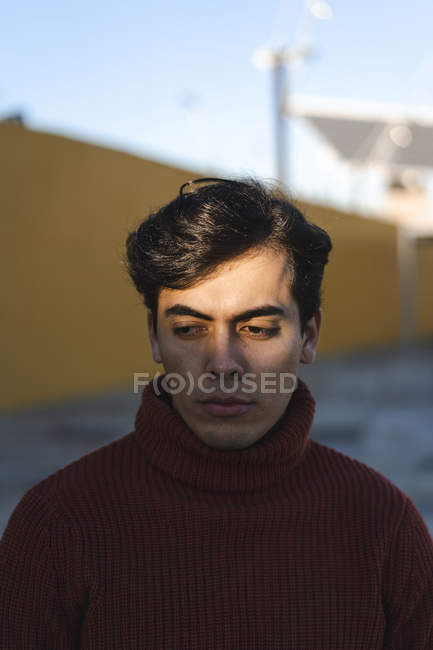 Portrait of young man wearing turtleneck pullover — стокове фото