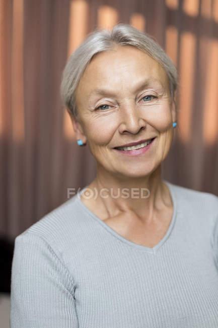 Portrait of smiling senior woman — Stock Photo