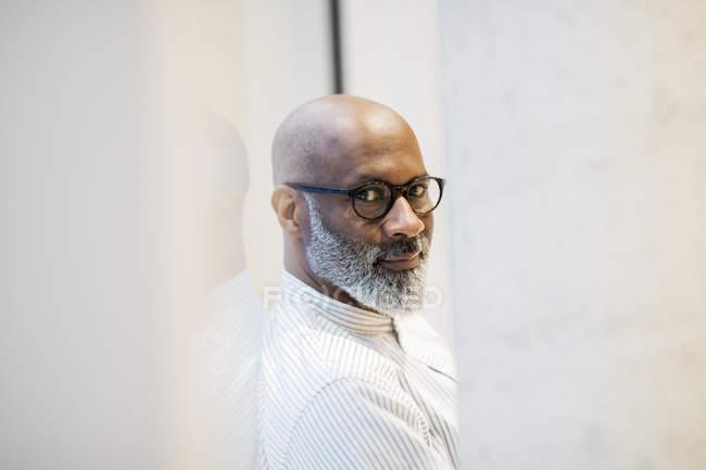 Portrait of bald mature businessman with grey beard wearing glasses — Stock Photo