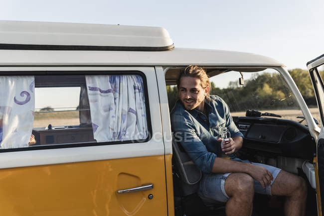 Young man on a road trip with his camper, taking a break — Stock Photo