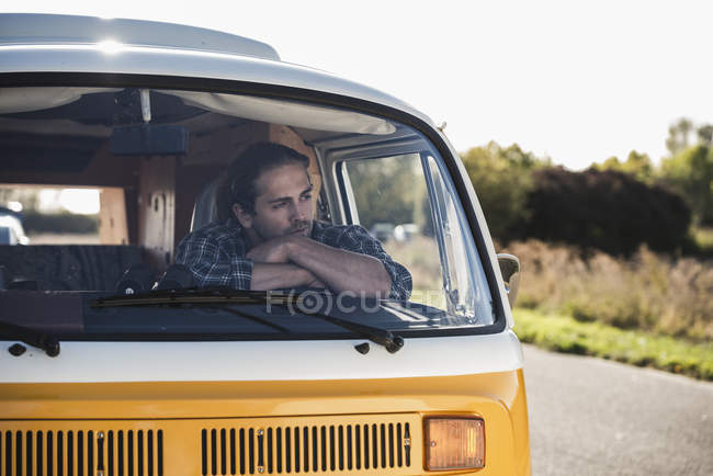 Young man on a road trip with his camper, taking a break, relaxing — Stock Photo