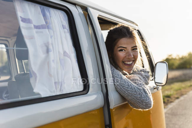 Pretty woman on a road trip with her camper — Stock Photo
