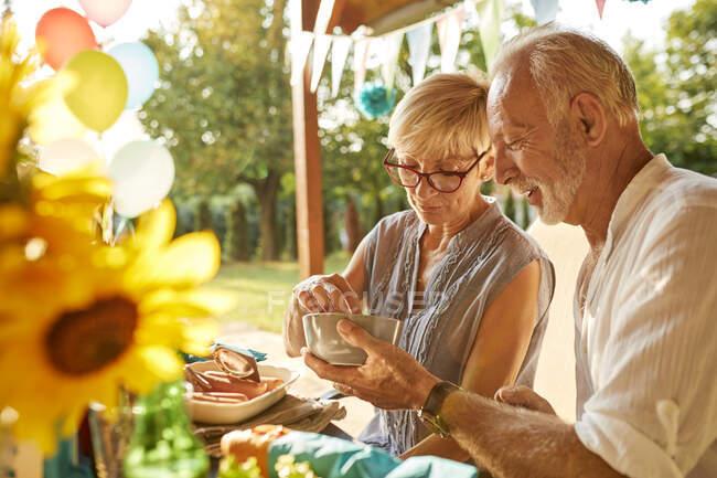 Senior couple on a garden party — Stock Photo