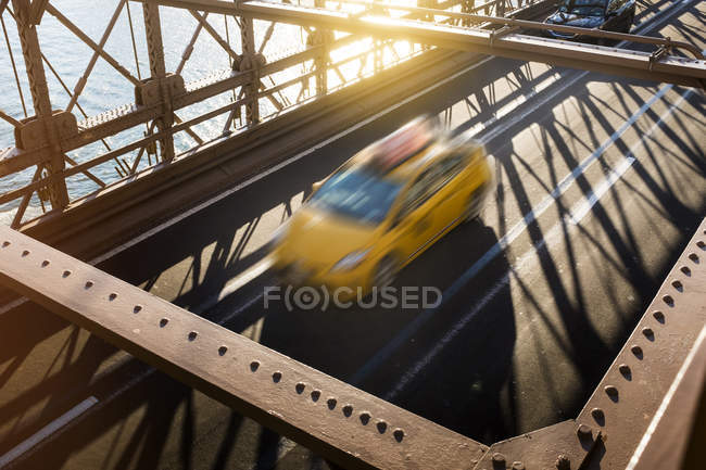 USA, New York City, Brooklyn, driving yellow cab on Brooklyn Bridge — Stock Photo