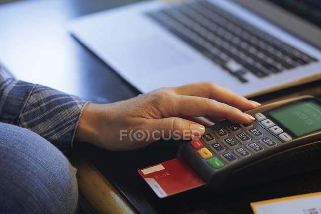 Woman with laptop using online banking, close-up — Stock Photo