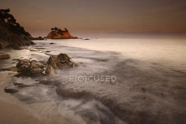 Spain, Castell-Platja d'Aro, Belladona Cove at sunset — Stock Photo