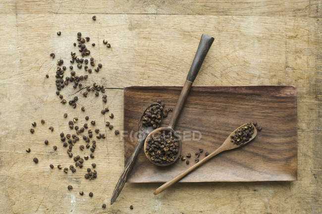 Wooden spoons with Szechuan Pepper — Stock Photo