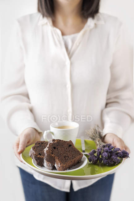 Homemade chocolate cake and cup of coffee on plate — Stock Photo