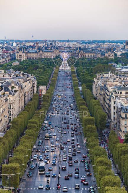France, Paris, cityscape with Avenue des Champs-Elysees and Louvre — Stock Photo