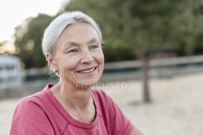Portrait of relaxed senior woman outdoors — Stock Photo