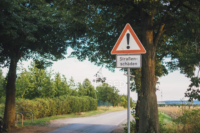 Germany, warning sign 'roadway damages' — Foto stock