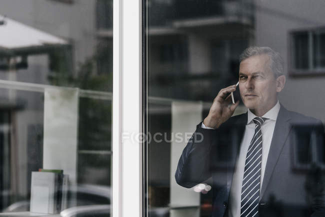 Mature businessman on cell phone — Stock Photo