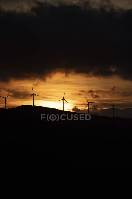 Spain, Andalusia, Tarifa, wind wheels on mountain at sunrise — Stock Photo