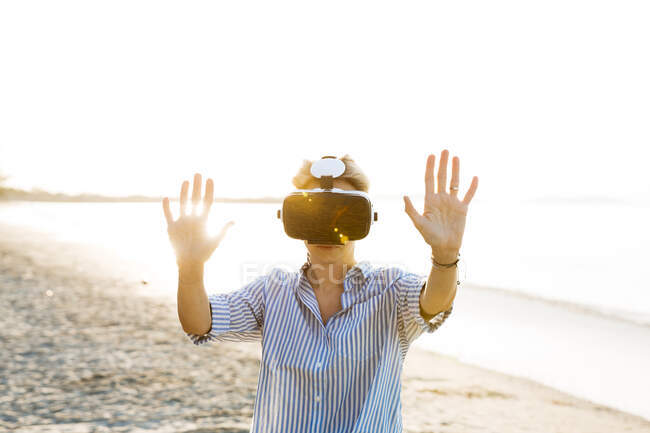Thailand, woman using Virtual Reality Glasses on the beach — Stock Photo