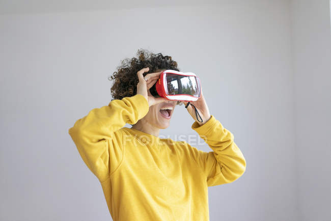 Excited woman wearing VR glasses — Stock Photo
