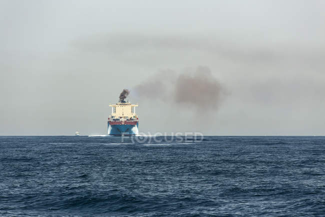 Spain, Andalusia, air pollution by cargo ship — Stock Photo