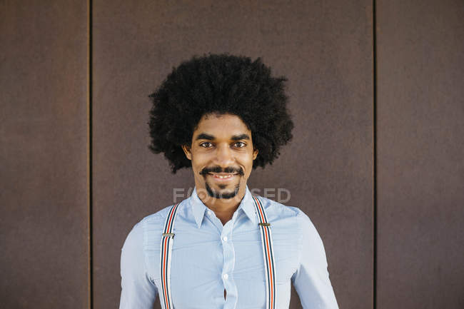 Portrait of smiling man against rusty background — Stock Photo
