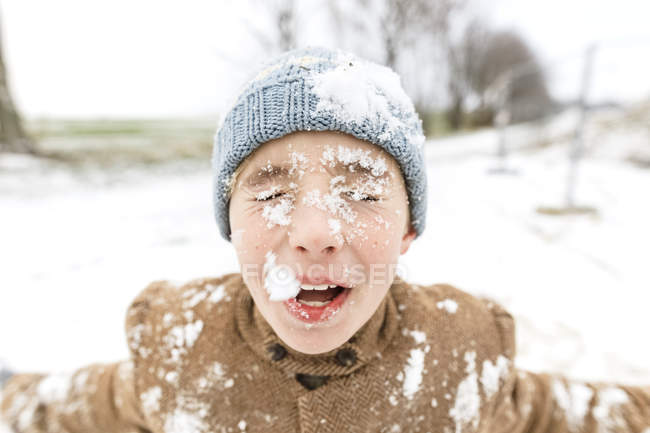 Portrait of boy with snow in his face — Stock Photo