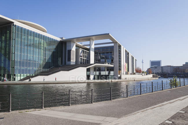 Germany, Berlin, Regierungsviertel, Marie-Elisabeth-Lueders-Building at Spree river and TV Tower Berlin in the background floor plate marking the former Berlin Wall — Stock Photo