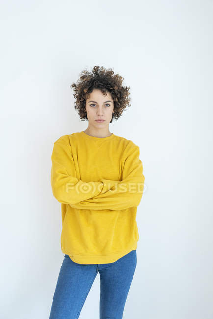 Portrait of confident woman wearing yellow sweater — Stock Photo