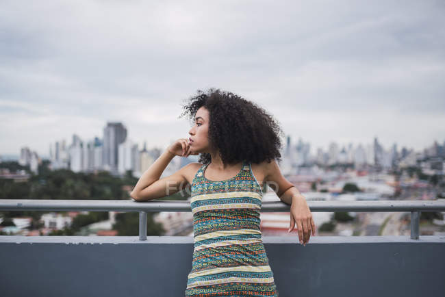 Panama, Panama City, pensive young woman on balcony looking at distance — Stock Photo
