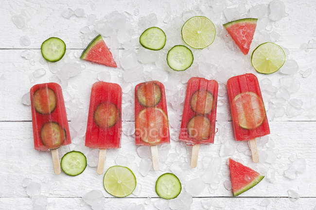 Homemade watermelon cucumber ice lollies on white ground — стоковое фото