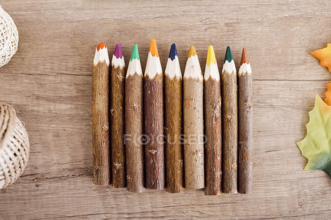 Wooden coloured pencils in a row — Stock Photo