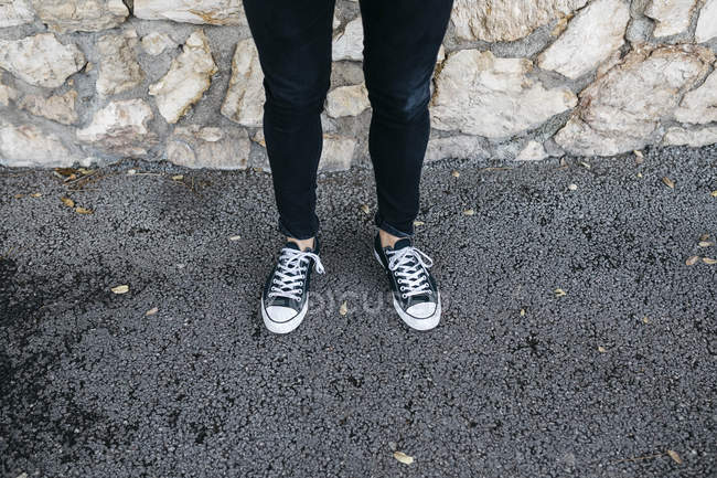 Legs of young man wearing casual clothes standing — Stock Photo