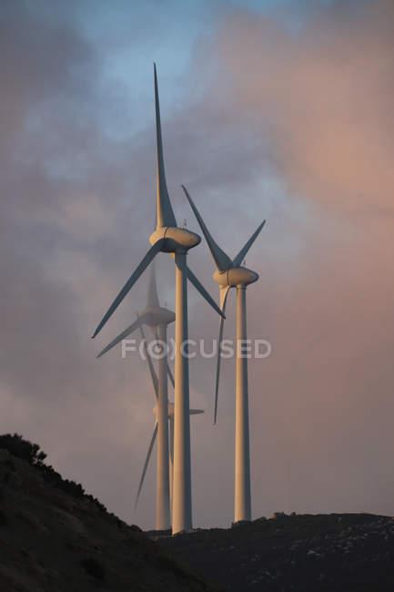 Spain, Andalusia, Tarifa, wind wheels at twilight — Stock Photo
