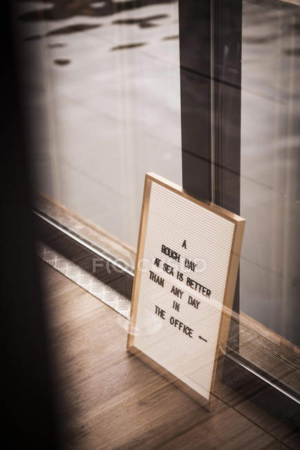 Sign with a saying on a housebout — Stock Photo