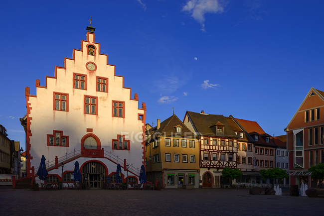 Germany, Bavaria, Karlstadt, town hall and market square in the evening light — Stock Photo
