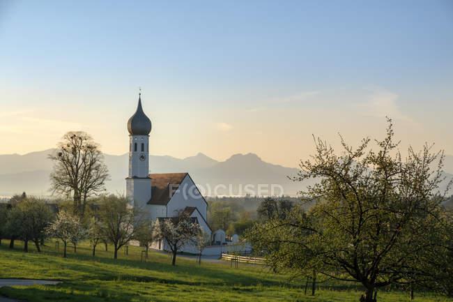 Germany, Bavaria, Upper Bavaria, Bad Feilnbach, Dettendorf, St. Korbinian Church in the morning — Stock Photo