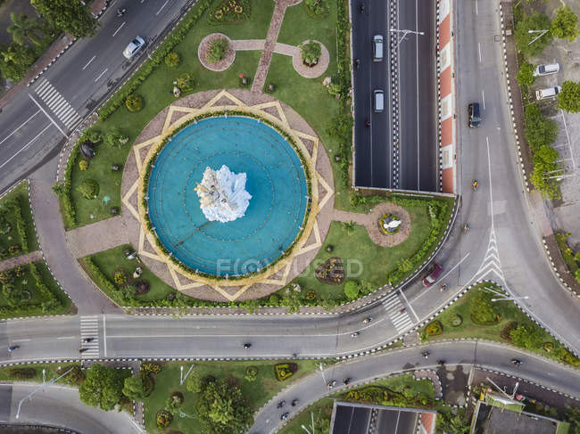 Indonesia, Bali, Denpasar, Aerial view of Patung Dewa Ruci statue at crossroads with tunnel — Stock Photo