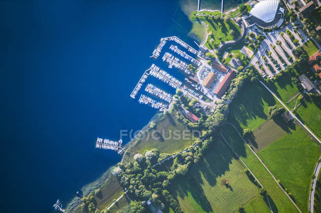 Germany, Bavaria, Chiemgau, Aerial view of Lake Chiemsee, Prien, harbour, swimming bath — Stock Photo