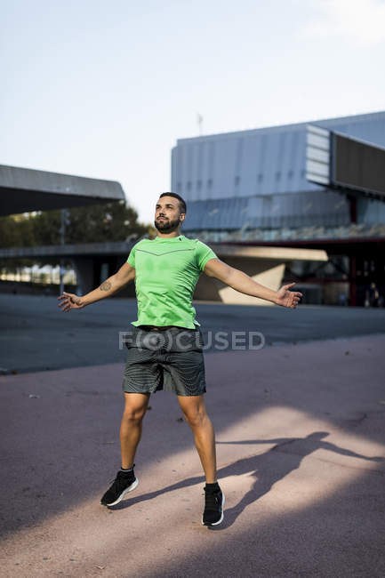 Sportive man during workout, jumping jack — Stock Photo