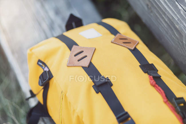Yellow backpack, lashing strap, close up — Stock Photo