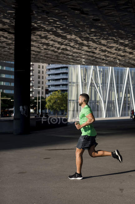 Sportive man during workout, jogging — Stock Photo