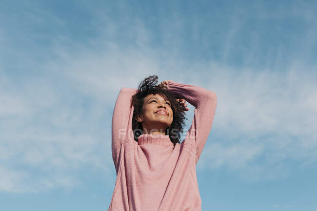 Portrait of happy young woman enjoying sunlight — Stock Photo