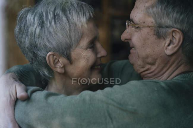 Affectionate senior couple hugging — Stock Photo