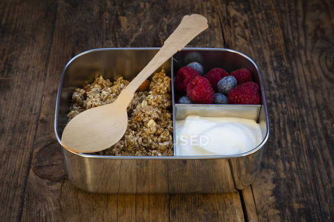 Breakfast box with granola, quinoa nuts, greek yogurt, blueberries and raspberries — Stock Photo