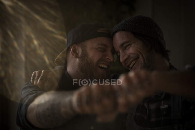 Friends holding fists together, showing their tattoos — Stock Photo