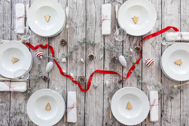 Laid table with Christmas decoration — Stock Photo