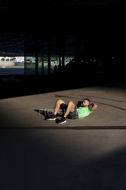 Sportive man during workout, sit-up — Stock Photo