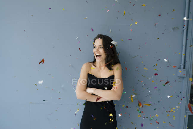 Happy woman watching flying confetti — Stock Photo