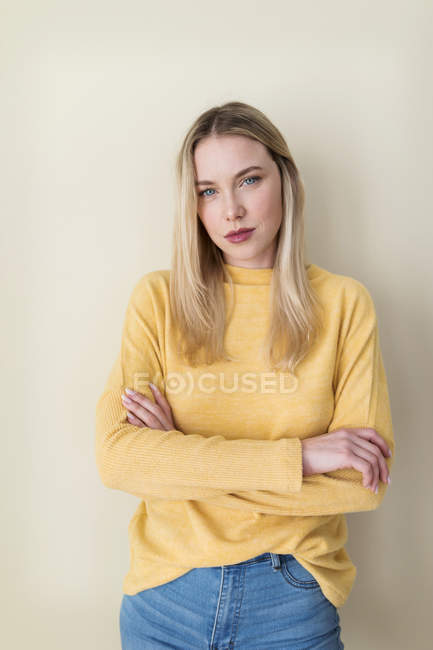 Portrait of a young woman, with arms crossed — Stock Photo