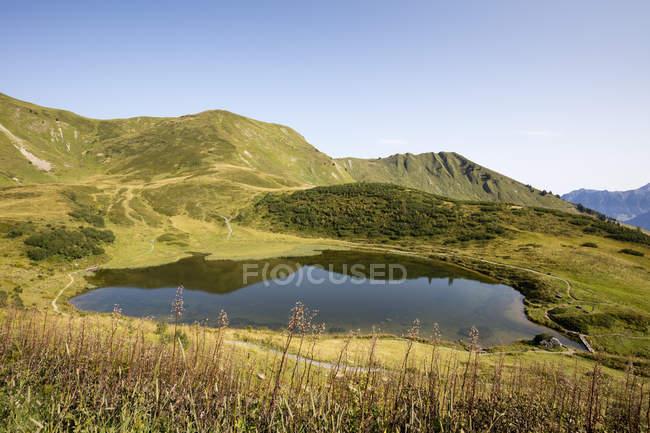 Alemania, Baviera, Allgaeu, Allgaeu Alpes, Fellhorn, Lago Schlappoltsee - foto de stock