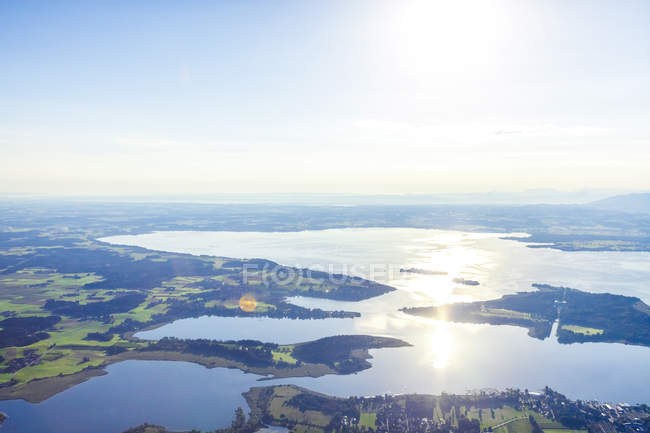 Germany, Bavaria, Chiemgau, Aerial view of Prien and lake Chiemsee — Stock Photo